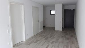 Wohnzimmer und offene Küche Wohnung 14 Richtung WE-Tür